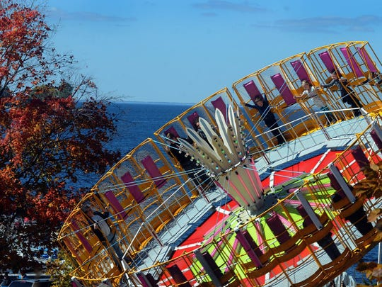 Tina says: The color of the carnival rides matches the fall colors of the nearby foliage during the 30th edition of Pumpkin Patch in Egg Harbor.