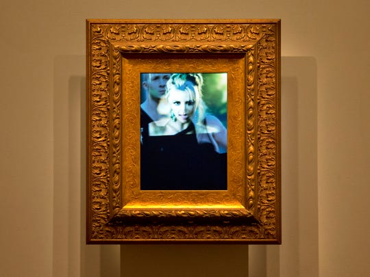 """The piece, """"(Pop) Icon: Britney, 2010"""" by artist Luke Dubois, is a digital video with custom wood frame that is part of the gallery, """"Eye Pop: The Celebrity Gaze,"""" at the National Portrait Gallery as seen on Monday May 18, 2015, in Washington."""