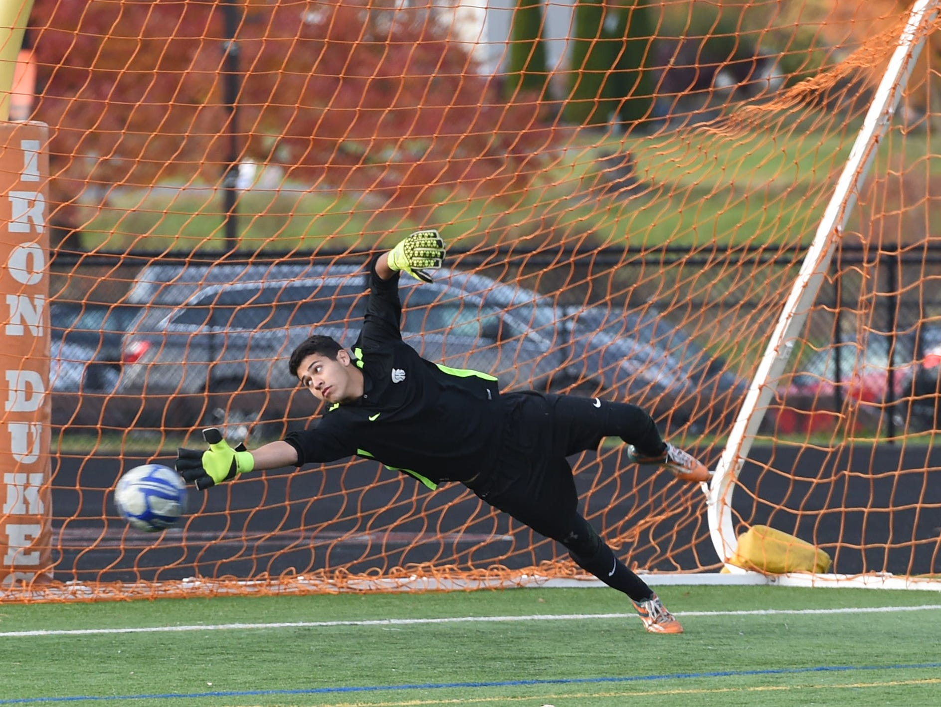 Spackenkill's Ryan Espinoza deflects a penalty kick during the Section 9 Class B final held in Marlboro on Saturday.
