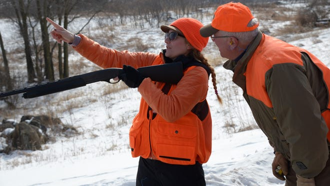 Maggie Chilsen of Madison gets shotgun-shooting tips from her mentor, Pat Zimmer of Hubertus.
