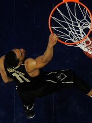 Vanderbilt forward Jeff Roberson (11) drives in a dunk