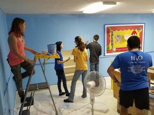 To earn the Stripes and Stars award from the American Heritage Girls organization, Victoria Peterson led other members of her troop to paint a mural for a children's room at Brighton Park Baptist Church.