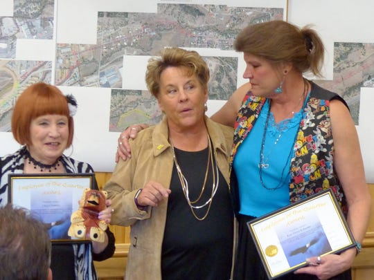Cheryl Volosin and Kari Dawn Kolander shared the award for community service, just as they share space in the children's department of the Ruidoso Public Library.
