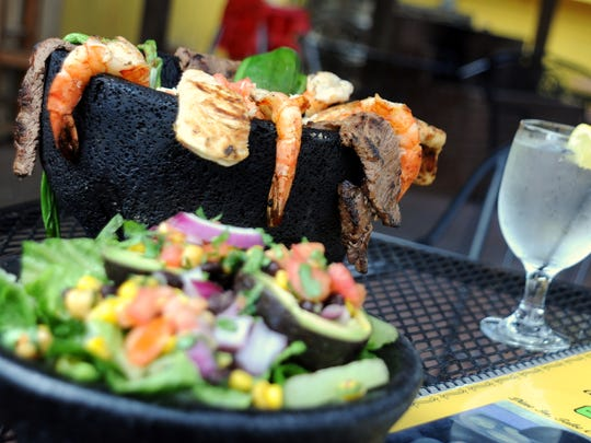 The Molcajete features chicken, steak, shrimp, Anaheim peppers, onions, whole beans, chorizo and cheese in a hot stone bowl and has been popular since Ole's Guacamole began offering it a year ago.