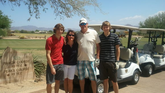 The Breidenbach family, from left to right, Adam, now 20, mom Laura, dad Michael and Brandon, now 22, golfing at Tonto Verde, Arizona.