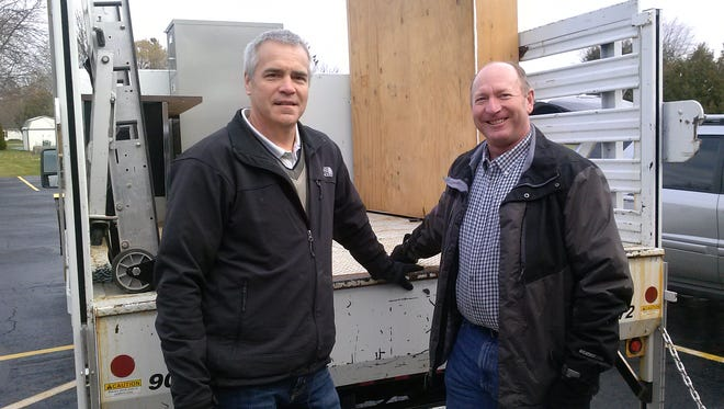 Dominion employees Tim Olson, left, and Jeff Helbirg helped Literacy Partners of Kewaunee County with their move from Kewaunee to the United Methodist Church in Algoma.