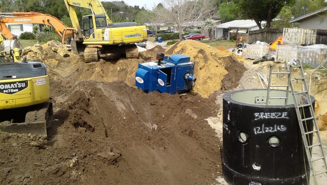 Workers last year switched homes in Breeze Swept subdivision in Rockledge from septic tanks to central sewer.