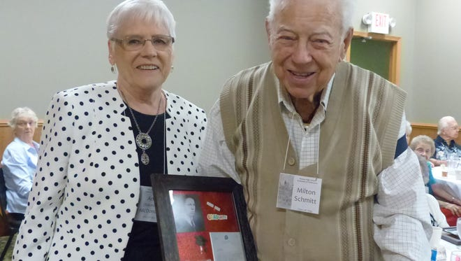 Ann McDonald presents a plaque to Milt Schmitt, age 102, of the Class of 1933, during the 2016 YesterYears reunion of Wausau High School.