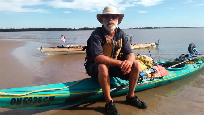 Former Livingston Daily Press & Argus editor Mike Malott, of Hartland Township, sits on his kayak at the mouth of the Atchafalaya River on the final day of his 72 journey down the Mississippi River with Dave Randolph of Clinton, Illinois.