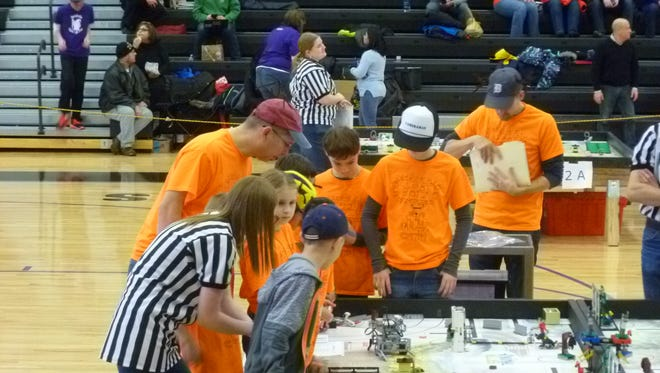 The Spot Botz team operates its robot in the arena at the Bloomfield Hills state competition.