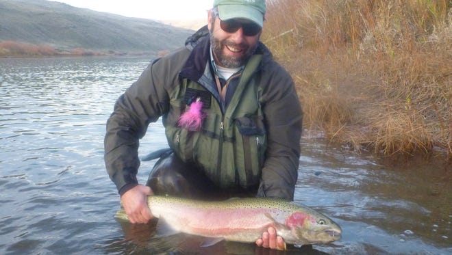 """Chris Santella, author of """"The Tug is The Drug"""" and many other books, caught this steelhead on the John Day River in Oregon while fly fishing. Santella will speak at the Vero Beach Book Center beginning at 6 p.m. Tuesday."""