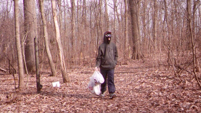 A trail camera caught this image of a person wearing a ski mask just prior to a brush fire starting in Springettsbury Township.