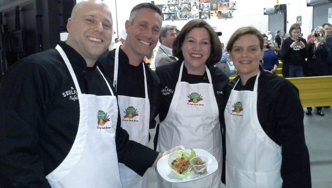 Members of the Soulfull Project team show off their winning dish at last year's Hunger Games event. From left are: Bob Hennessey, Chip Heim, Megan Shea, and Lisa Schipsi.