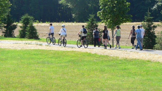 The new three-mile Kinkora trail through field and forest in Mansfield, Burlington County, is used daily by bikers and pedestrians.