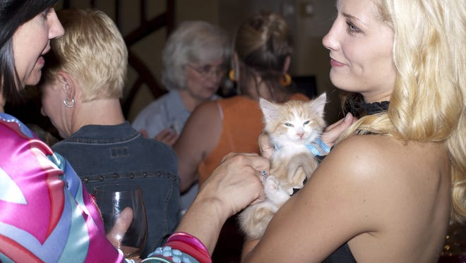 Pets and people mingle at the 2009 Whine & Dine.