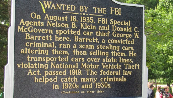 An Indiana Historic Landmarks marker noting the site of a 1935 shootout that killed an FBI agent was dedicated in West College Corner, Ind., on Aug. 16, 2017.