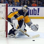 Buffalo Sabres goalie Michal Neuvirth makes a stick save during the third period against the Anaheim Ducks at First Niagara Center.