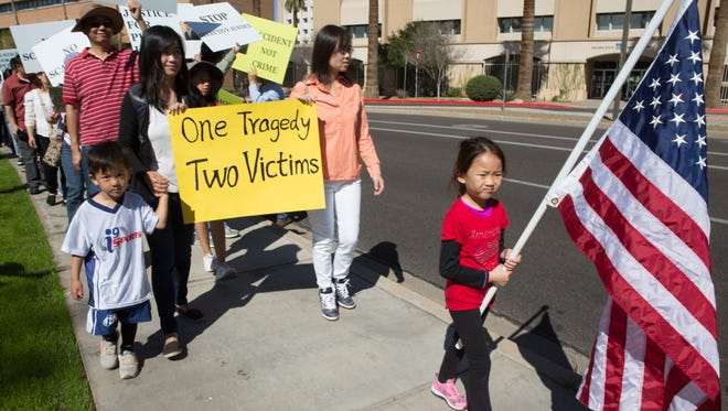 Son Mimyi Cao, 4 (left) marches with his mother Cathy Huang (right,) Ji Wu (seond right,) and Wu's daughter Sunan Zhang, 6, at a protest against the recent conviction of New York police Officer Peter Liang outside of the state Capitol at Bolin Park on Feb. 20 2016 in Phoenix, Ariz. The protest was put on by the Chinese American community in Arizona in unity with Chinese American communities across the country in response to Liang's guilty verdict in a recent manslaughter case.