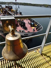 The bell of the Barbara Carol Ann Moran located on the bow of the tug's pilot house six stories up, overlooks its companion Louisiana barge at Bay Shipbuilding Co. on Friday, May 20.