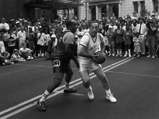 File photo: Gov. Mario Cuomo, right, takes on State Assemblyman David Gantt in a one-on-one basketball game on Main Street in Rochester during the 1990 Jumpin' Jack Shootout.