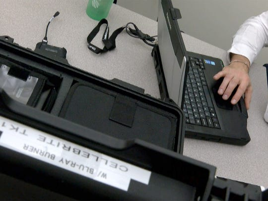 Detectives use the Cellebrite system to extract information from cellphones at the NJ Regional Internet Crimes Against Children Task Force Friday, January 12, 2018, at the State Police facility in Hamilton Township.  The digital investigation unit here is key to the detection of pedophiles online and building cases against them.