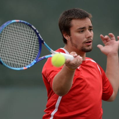Richmond's Jacob Weiss returns the ball during the tennis sectional championship Friday Oct. 2, 2015 at Richmond.