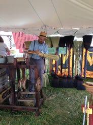 John Warren of Country Brooms demonstrates his craft