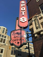 A sign for Chicago-based Broken English Taco Pub appeared