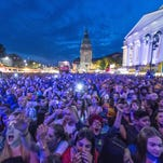 People enjoy a concert during the Schlossgrabenfest music festival in Darmstadt, Germany. German police arrested three asylum seekers after women made complaints of sexual assaults at the festival.