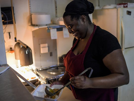 Rachelle Washington places an order of catfish into a plate lunch at Veronica's Cafe in Carencro.