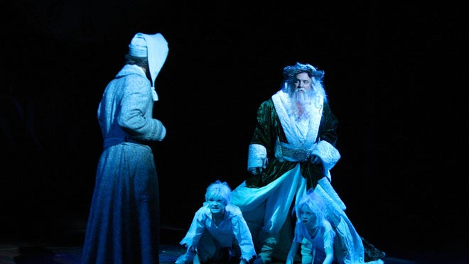 Chris Mixon as the Ghost of Christmas Present and Guy Paul as Scrooge with Aiden Fish and Bria Melrose as Ignorance and Want. This ghost is meant to age while he's with Scrooge.