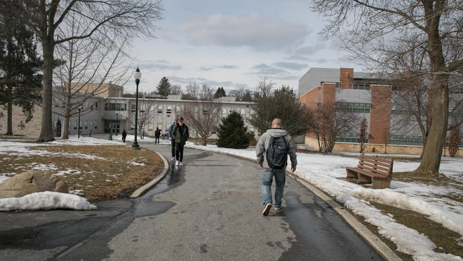 Students walk at SUNY Orange in Middletown. SUNY officials have estimated between 22,000 to 25,000 students received the Excelsior Scholarship in fall 2018.