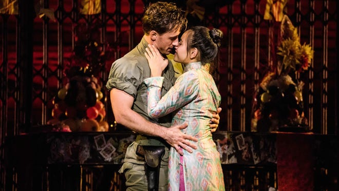 "Emily Bautista portrays Kim and Anthony Festa plays Chris in the revival of ""Miss Saigon"" that opens Tuesday at the Kravis Center in West Palm Beach."