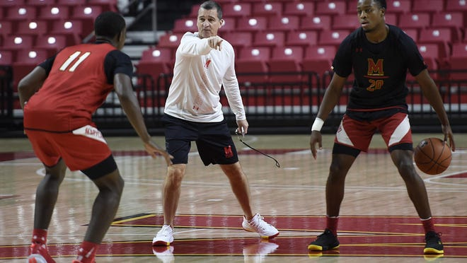 Maryland basketball head coach Mark Turgeon, center, runs practice with Darryl Morsell, left, and Travis Valmon during Media Day, Oct. 15, 2019 in College Park, Md.