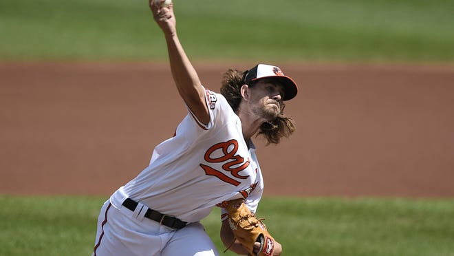 Baltimore Orioles pitcher Dean Kremer delivers a pitch against the New York Yankees during the first inning of a baseball game Sunday in Baltimore, Md.