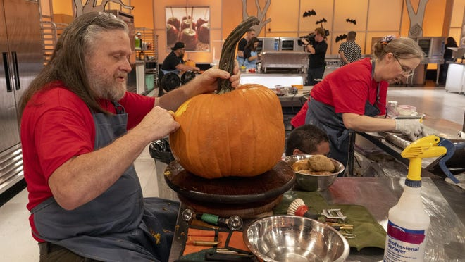 "Deane Arnold, left, and cake maker Heather Sherman work during the season premiere of ""Halloween Wars."""