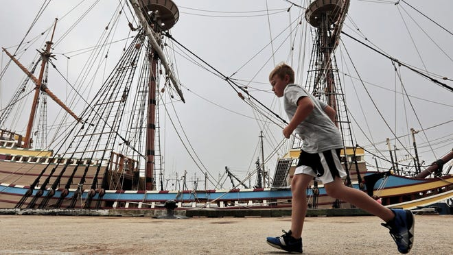 Kaleb Reynolds, 9, makes his way across State Pier to get a closer look at the Mayflower II. The Mayflower II made an unscheduled overnight stop at State Pier in New Bedford to ride out Tropical Storm Isaias.