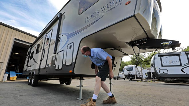 David Rousseau takes a walk around a top of the line Rockwood Signature series RV which was just sold and is being picked up by customer on Saturday at Rousseau's RV Center on Bedford Street in Lakeville.