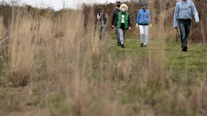 People walk one of the many trails found at the DNRT Ocean View Farm property in Dartmouth.
