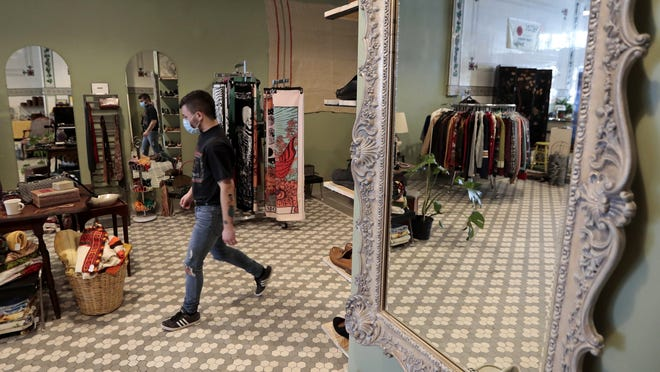 Owner Myles Goulart makes his way across the sales floor in the newly opened Hewn a non-binary boutique on Purchase Street in downtown New Bedford.