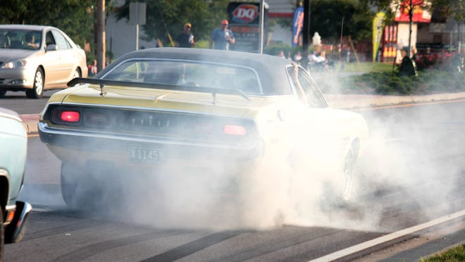 One of the cars at the 2013 Super Cruise does a burnout on Hebron Road, Heath.Advocate file photo