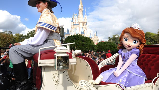 "In this handout photo provided by Disney, Disney Junior princess ""Sofia the First"" takes a royal ride in a horse-drawn carriage while taping the ""Disney Parks Christmas Day Parade"" TV special in the Magic Kingdom park at Walt Disney World."