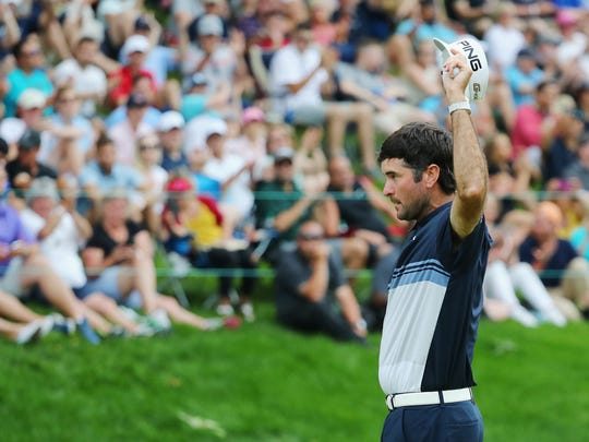 CROMWELL, CT - JUNE 24:  Bubba Watson of the United States waves to the gallery after making a putt for birdie on the 18th green during the final round of the Travelers Championship at TPC River Highlands on June 24, 2018 in Cromwell, Connecticut.  (Photo by Tim Bradbury/Getty Images)