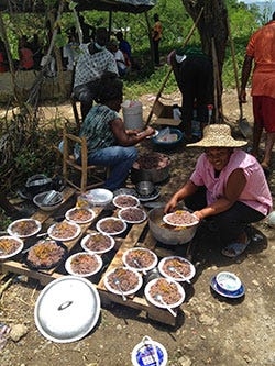 Food prepared for 'konbit' to celebrate and prepare the land for a new marketplace in Cange, Haiti.