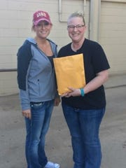 Sara Mohr (left), with gift card and cash donations,
