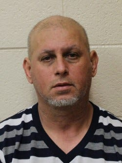 Frankie Hernandez, 53, was charged Tuesday after state police said he picked up a package from the post office containing 4 kilograms of heroin.