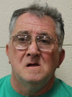 Harley Lynn Lewis, 63, was taken into custody April 5 after deputies said he violated a peace order filed against him by a neighbor because he continued throwing trash into his neighbor's yard.