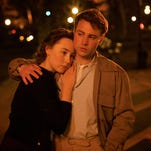 "Saoirse Ronan, left, and Emory Cohen in a scene from the film ""Brooklyn."""