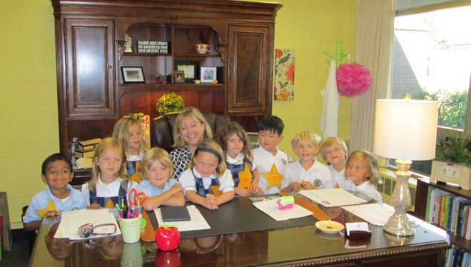 School director Jenny Bullock with some of her Detroit Country Day Lower School students.