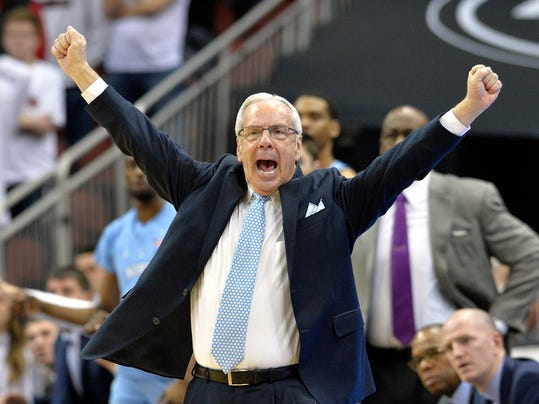 North Carolina head coach Roy Williams cheers his team during the second half of an NCAA college basketball game against Louisville, Saturday, Feb. 17, 2018, in Louisville, Ky. (AP Photo/Timothy D. Easley)
